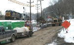 270 - Hydro Street is full of heavy equipment doing sewer work as the H74416 eases west past the signals at the west end of Reusens.